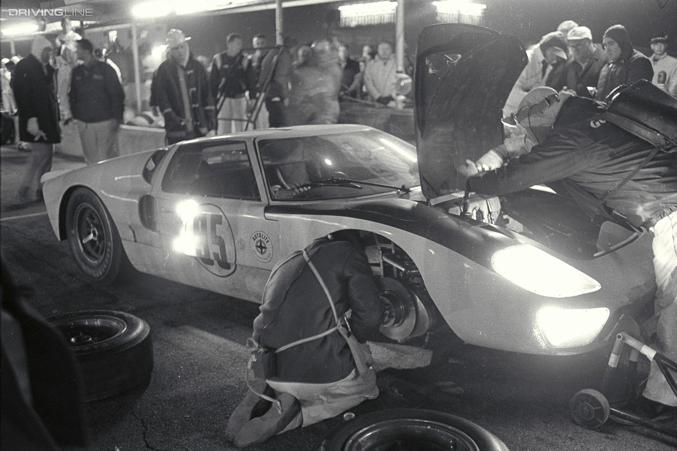 Daytona 24 Hour Race, Daytona, FL, 1966. Walt Hansgen/Mark Donohue Ford Mark II makes a pit stop. CD#0777-3292-0443-2